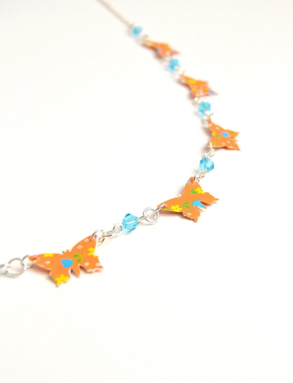 Necklace with orange paper butterflies and turquoise crystals